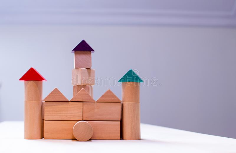 Bright colorful wooden blocks toy. Bricks children building tower, castle, house stock images