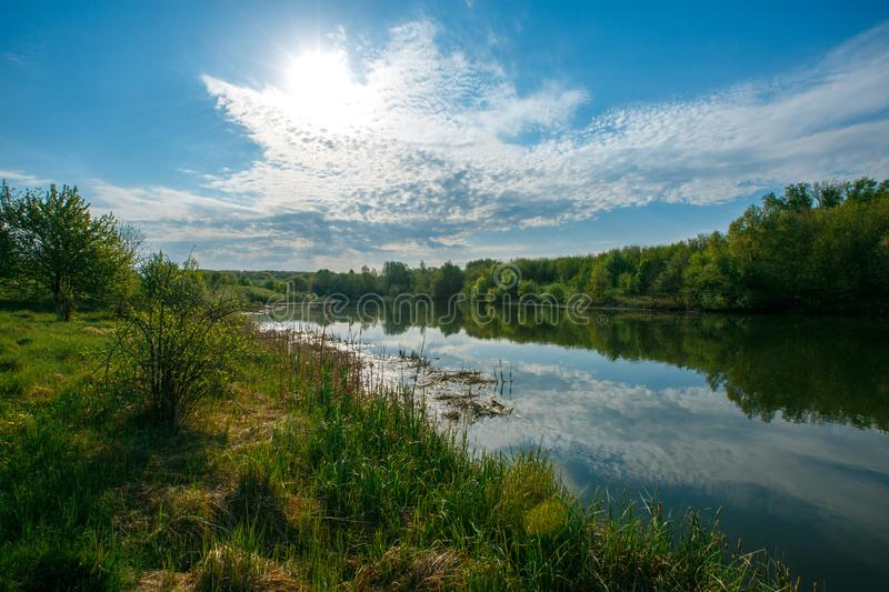 Bright colors of dawn on the river in summer stock photo