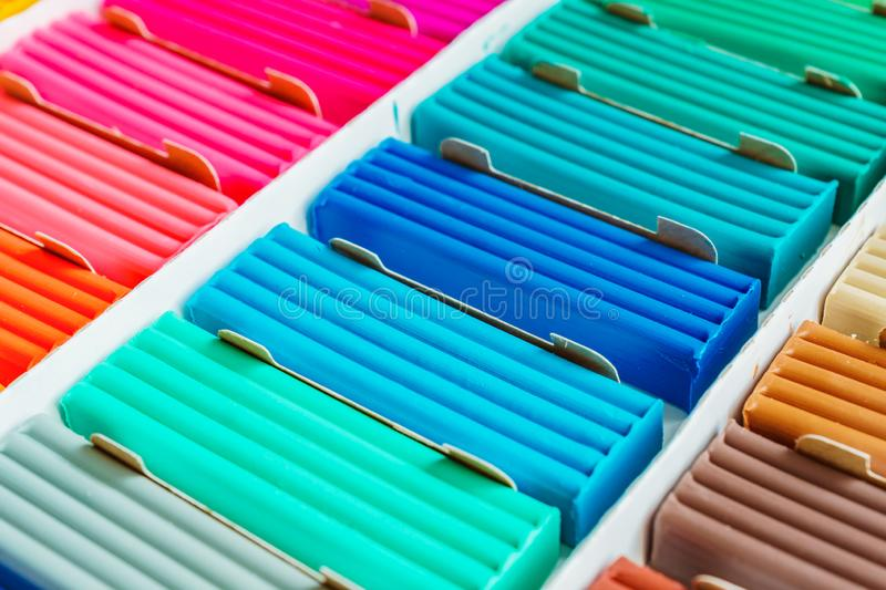 Bright colors of modeling clay. Multicolored plasticine bars ina box, background texture royalty free stock photography