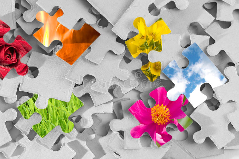 Bright Colors of Nature. Pile of gray puzzle parts with several parts made as images of nature royalty free stock photography
