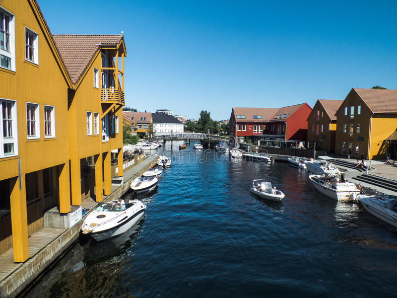 Bright coloured houses in Kristiansand, Norway. Houses on the water front with speed boats at the coastal resort of Kristiansand, Norway royalty free stock image