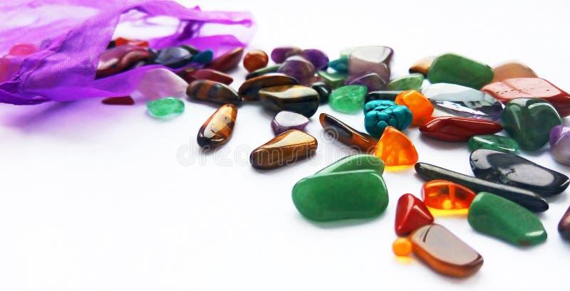 Bright coloured semi precious gemstones and gems stock images