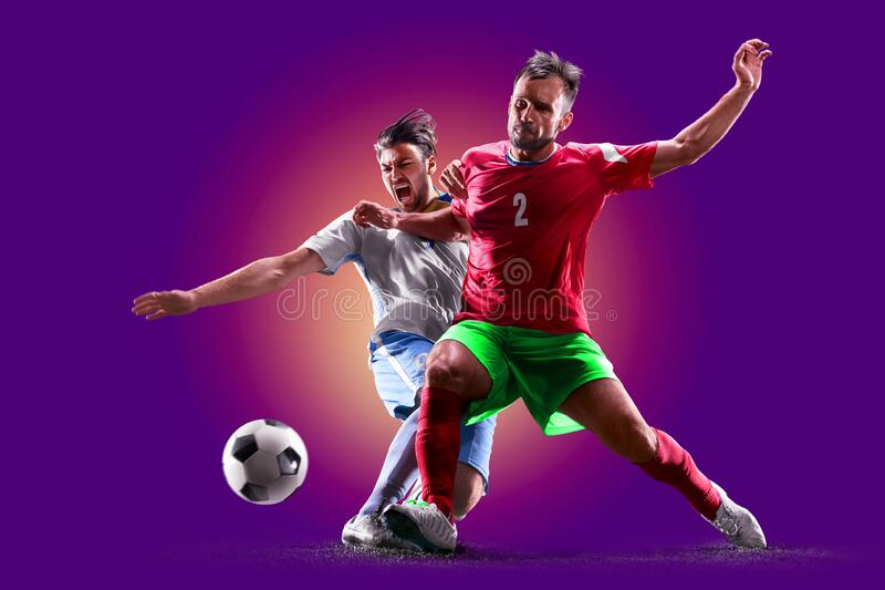 Colourful professional soccer players  over purple background royalty free stock photography