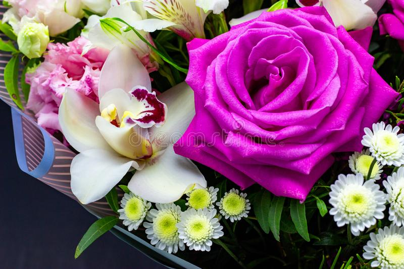 Bright contrasting bouquet of fresh flowers on a dark background stock photos
