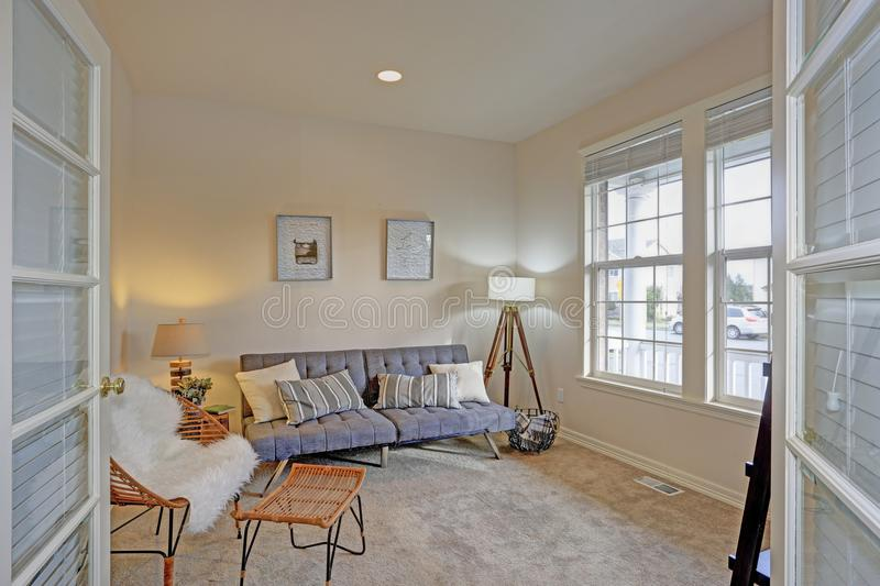 Bright and cozy living room with ivory walls royalty free stock photo