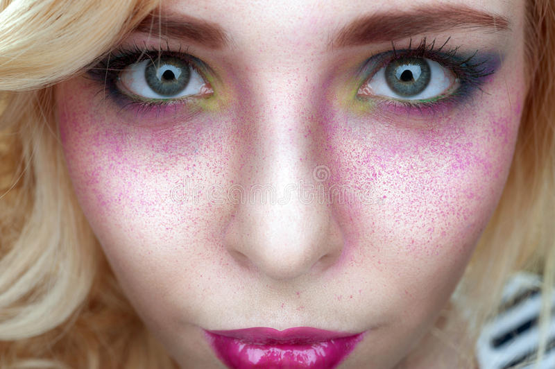 Bright creative make-up on woman face with powder on skin stock photo