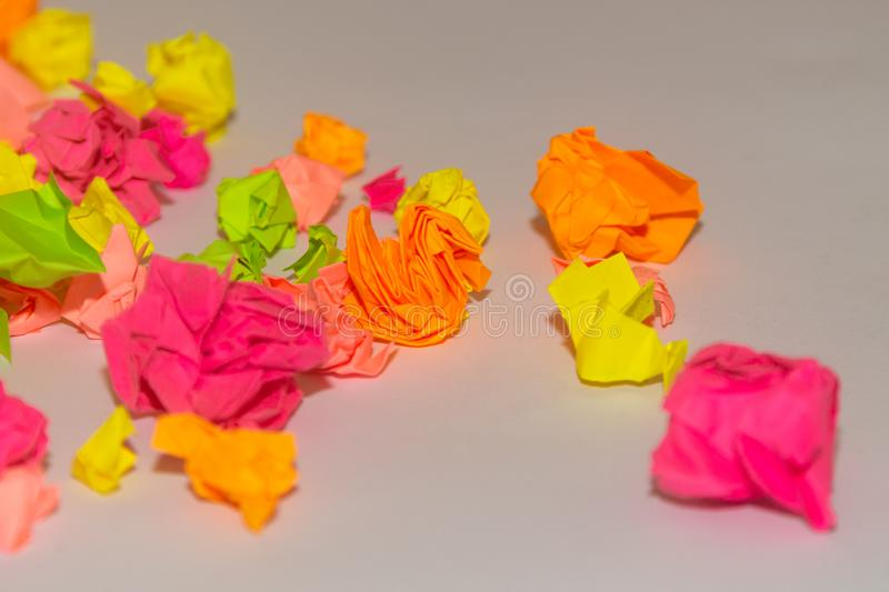 Bright crumpled multi-colored stickers on the office white board stock photography