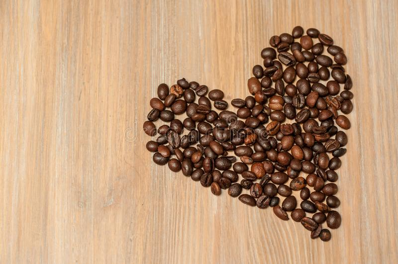 Coffee beans are laid out in the form of a heart stock photo