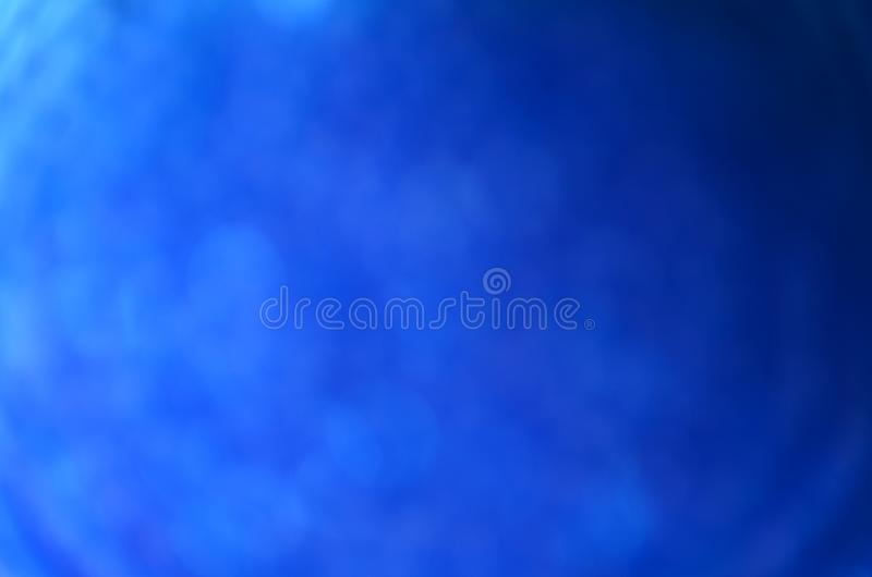 Gradient blue blurred bokeh background stock photo