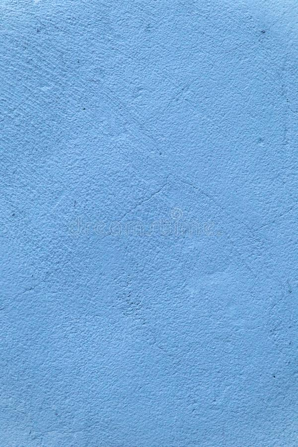 Bright deep saturated blue concrete wall background stock images