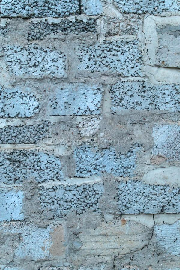 Bright deep saturated blue concrete wall bricks background stock image