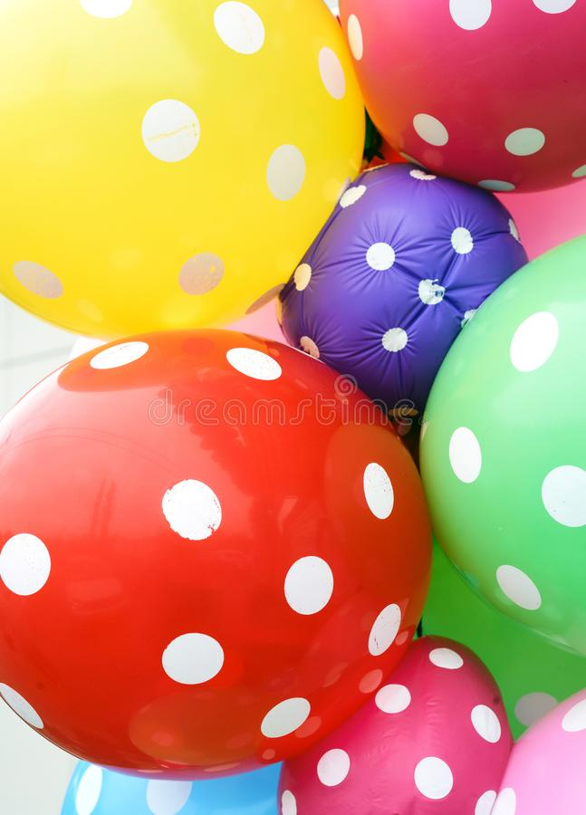 Bright Deflated Polka Dot Balloons. Bright multicoloured balloons with deflated little ones in polka dot design stock photos