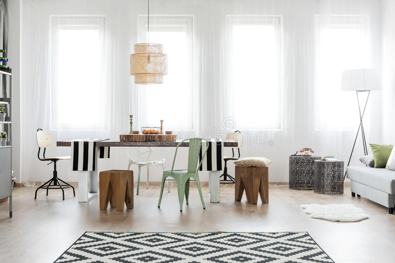 Bright dining room area. With modern furniture stock images