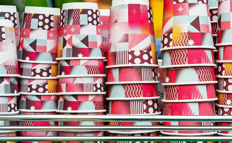 Bright disposable cups on the counter of an outdoor cafe. Paper cups for various drinks royalty free stock image