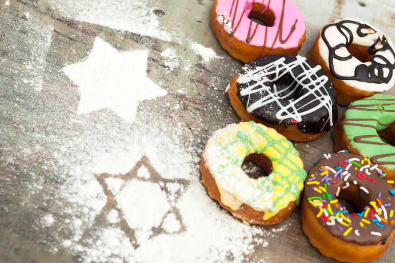 Bright donuts on wooden background stock images