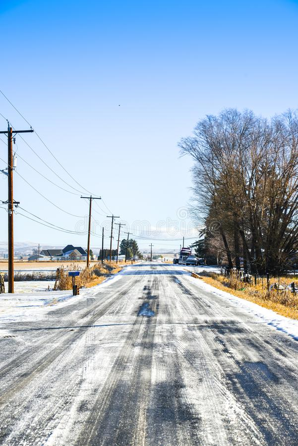 Country Road In Frozen Snow, Ellensburg, WA, USA. Bright early morning good weather in Ellensburg right after a winter snowstorm yesterday.  Under the bright royalty free stock photo