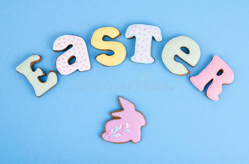 Bright Easter background.  Decoration eggs and colorful letters forming words  EASTER. Celebration concept. royalty free stock photography