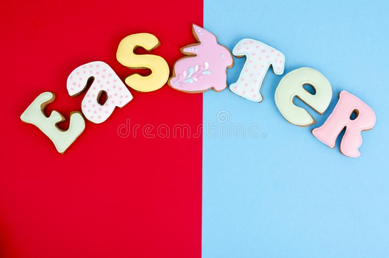 Bright Easter background.  Decoration eggs and colorful letters forming words  EASTER. Celebration concept. royalty free stock image