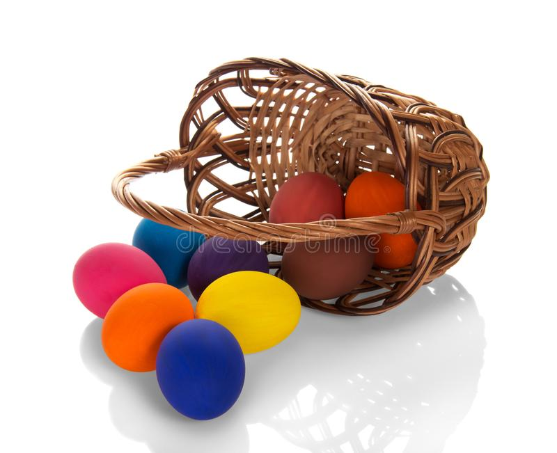 Bright Easter Sunday. Basket with colorful painted eggs isolated on white royalty free stock photo