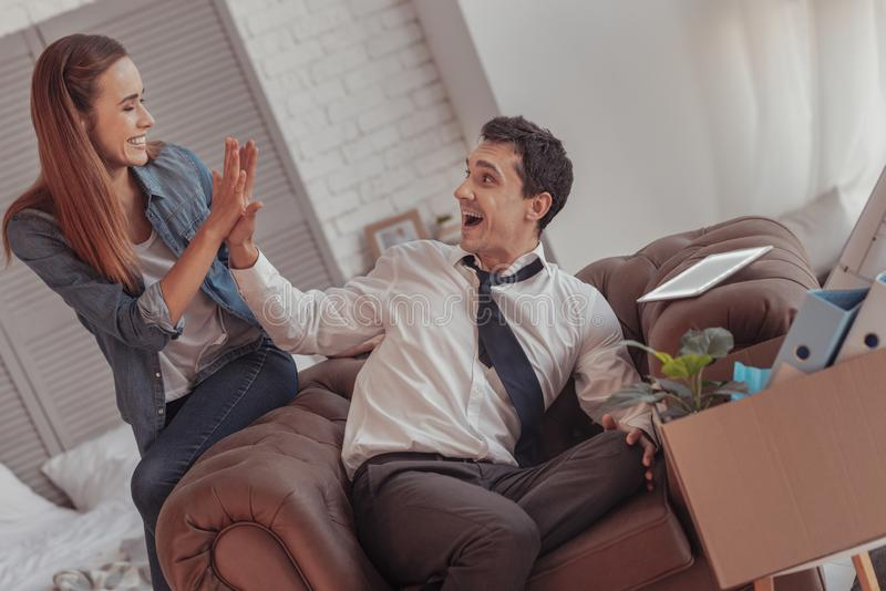 Contented couple giving high five royalty free stock photo