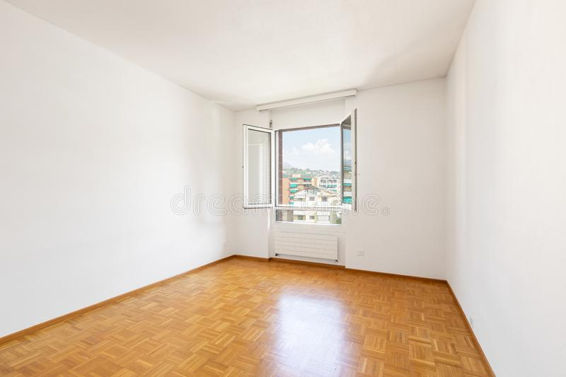 Bright empty room and nice parquet royalty free stock photo
