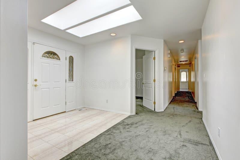 Long Foyer Xl : Bright entrance hallway with skylight stock image