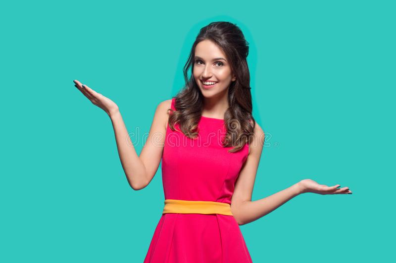 Bright fashion woman on a turquoise background. Pink dress. Pop Art stock photography