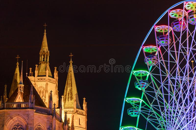 Bright Ferris wheel and famous cathedral Dom hill at night. Details. Erfurt, Germany royalty free stock photos