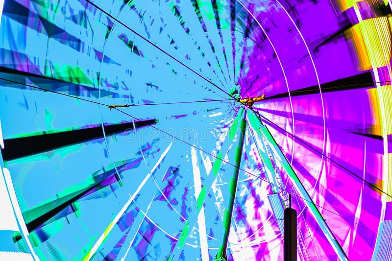 Bright Ferris wheel in motion. Abstract. Fragment stock photos