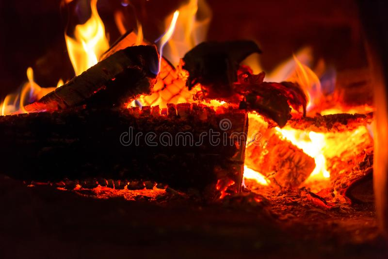 Bright fire red hot glowing logs fever for cooking dishes, background colorful base design hearth stock photo