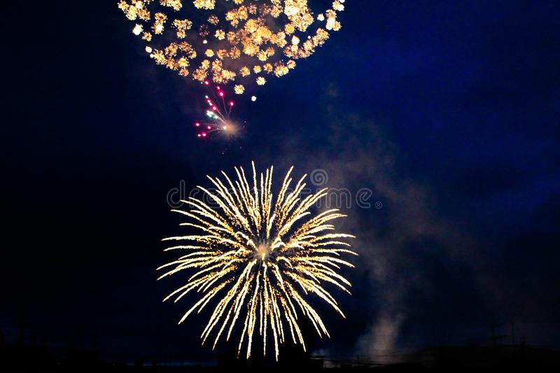 Bright fireworks in the night sky stock photos