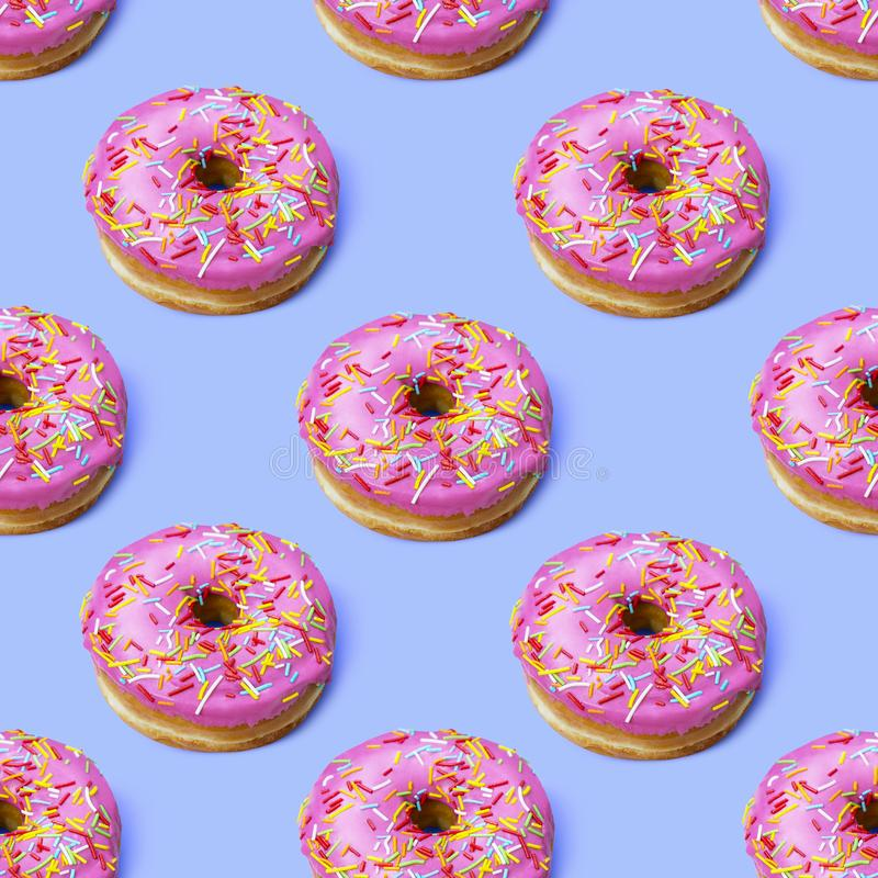 Flat lay donuts seamless pattern stock photography