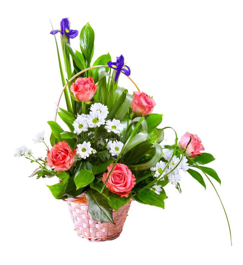 Bright flower bouquet in basket stock photos