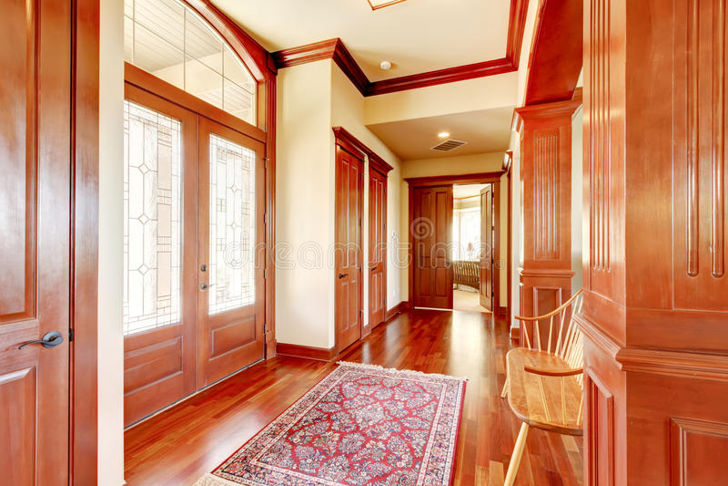 Bright foyer in luxury home with hardwood floor. stock image