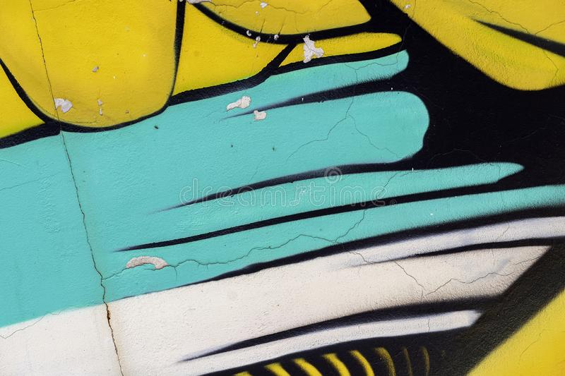 Bright fragment of wall with old chipped paint in colorful colors, scratch, grunge texture close-up. Modern abstract stock images