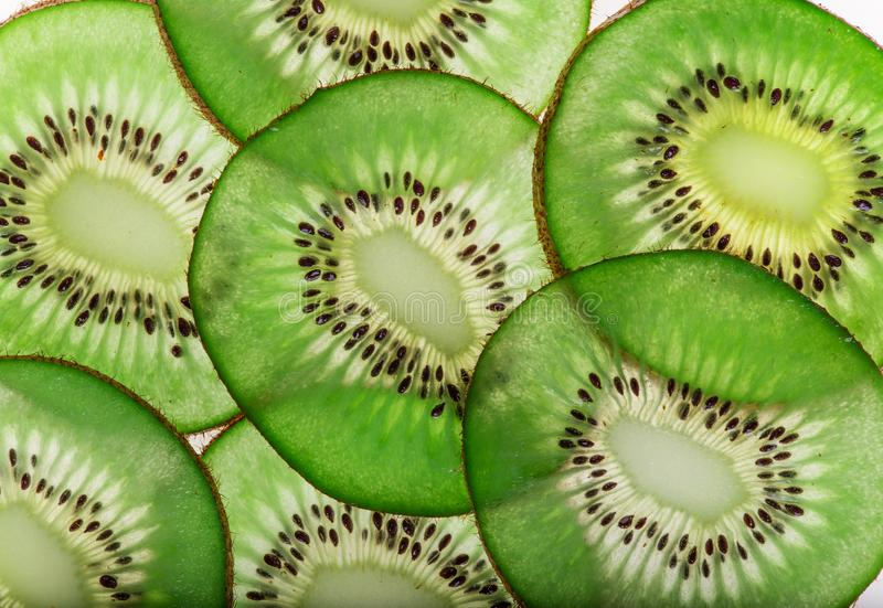 Bright fresh kiwi slices, back light transparent fruit. royalty free stock photos