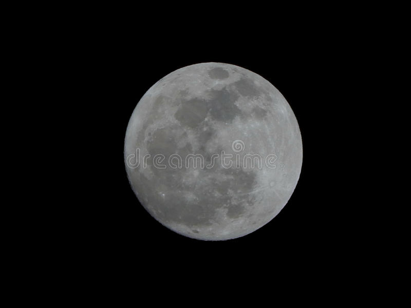 Bright Full Moon Isolated on a Natural Black Night Sky. A closeup detailed view of the bright full moon isolated on a natural black night sky stock photos