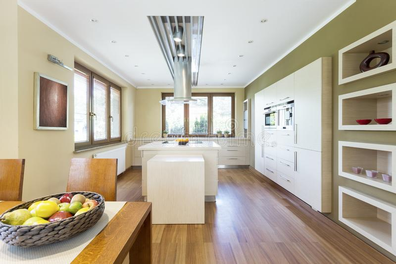 Bright functional kitchen with kitchen island royalty free stock photo