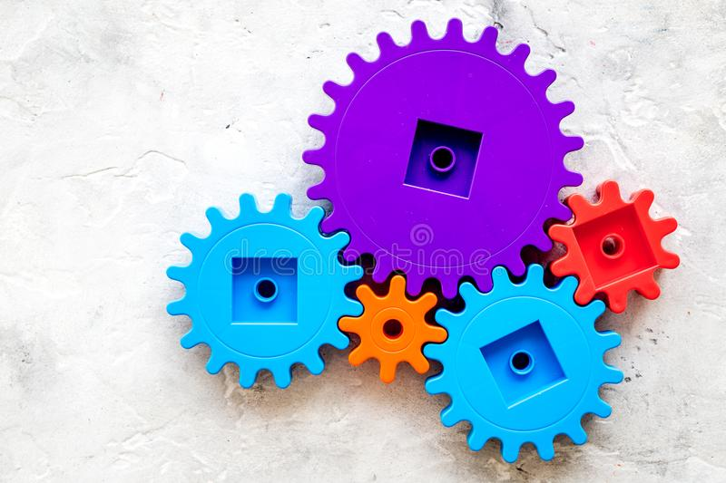 Bright gears for great technology of team work and correct mechanism on stone background top view copyspace stock photo