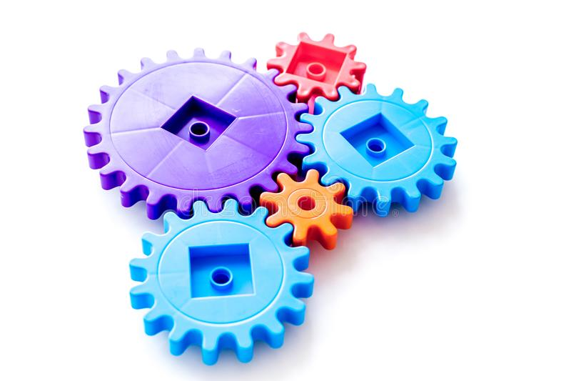 Bright gears for great technology of team work and correct mechanism on white background stock image
