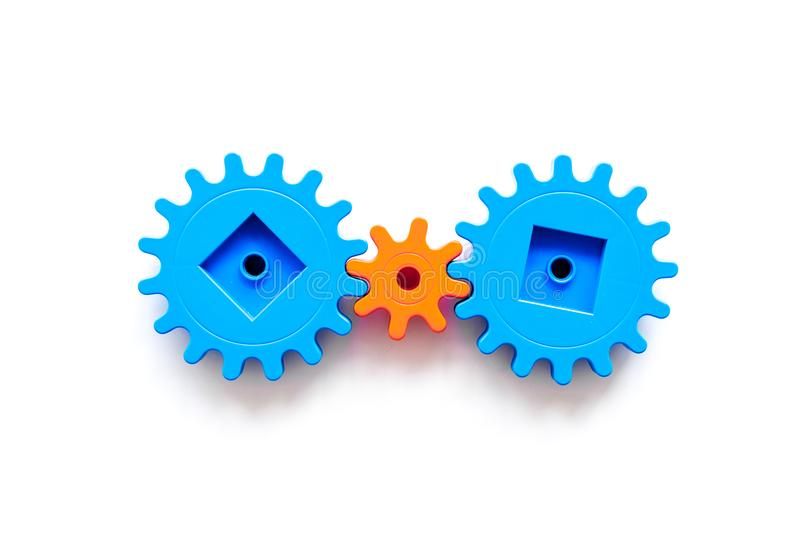 Bright gears for great technology of team work and correct mechanism on white background top view copyspace royalty free stock images