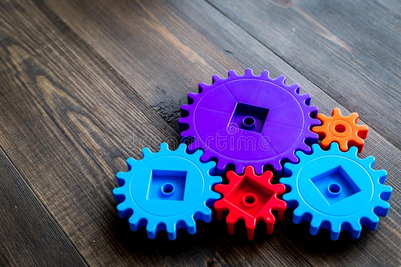 Bright gears for great technology of team work and correct mechanism on wooden background copyspace royalty free stock photography