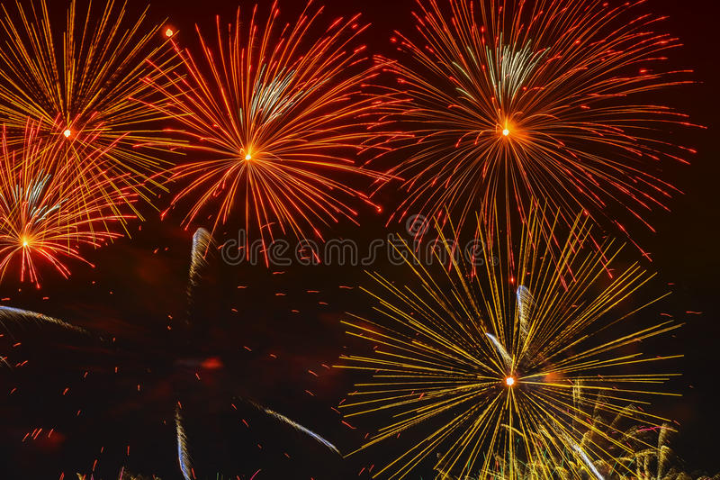 Bright golden glowing spheres and flickering stars, fireworks. Elegant background. New Year, Independence Day, all. Bright golden glowing spheres and flickering royalty free stock images