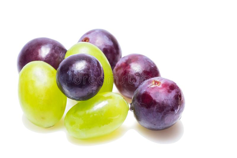 Bright grapes of bright varieties on a white background stock image