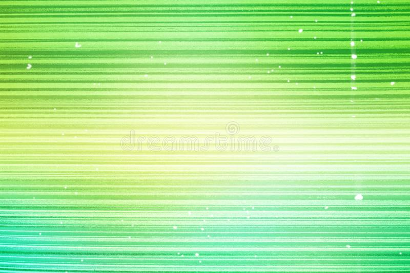 Wallpaper striped. Bright green background in a horizontal band of gold, darkened, vignette.Grunge light green banner texture. Blu. Bright green background in a royalty free stock photo