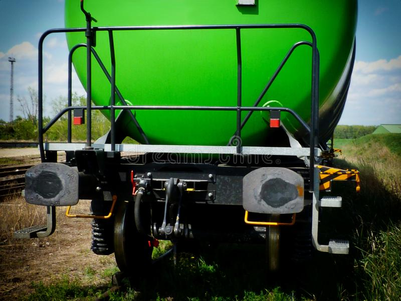 Green ethanol freight train in railroad station royalty free stock image