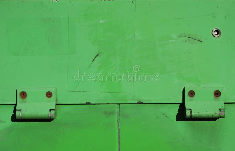 Bright green iron door in container royalty free stock photo