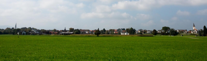 Bright green meadows and blue sky stock photos
