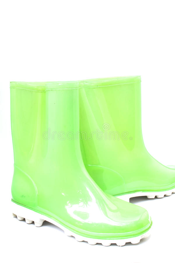Bright green rubber boots royalty free stock photos