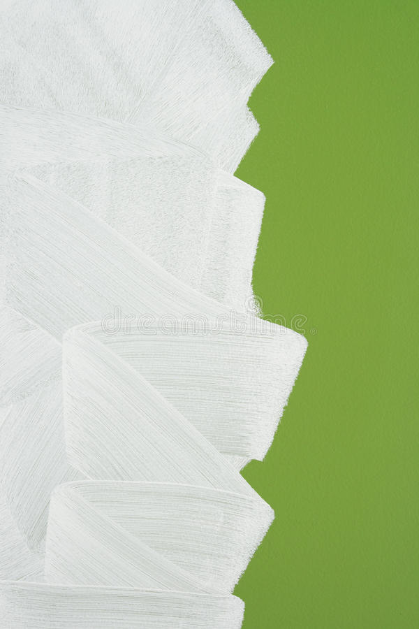 Bright green wall painted in white. With paint roller. Brush stroke texture stock photography